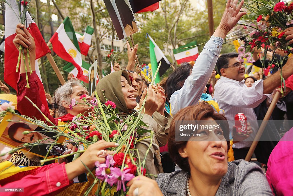 People toss flowers at a rally of groups opposing Iranian President Ahmadinejad's speech at the United Nations General Assembly on September 26, 2012 in New York City. Politicians including former New York Mayor Rudolph Giuliani, former House Speaker Newt Gingrich, former Homeland Security Secretary Tom Ridge, former New Mexico Governor Bill Richardson and former U.N Ambassador John Bolton spoke at the pro-democracy rally which also included Syrian pro-democracy protesters.