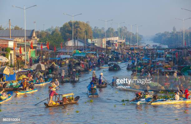 people trading in the river - Floating market at Nga Nam Soc Trang in the early morning