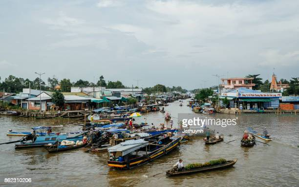 people trading with boat in the river - Floating market at Nga Nam Soc Trang