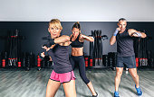 Group of people in a hard boxing training on fitness center