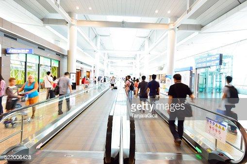 People transit the Incheon International Airport, South Korea