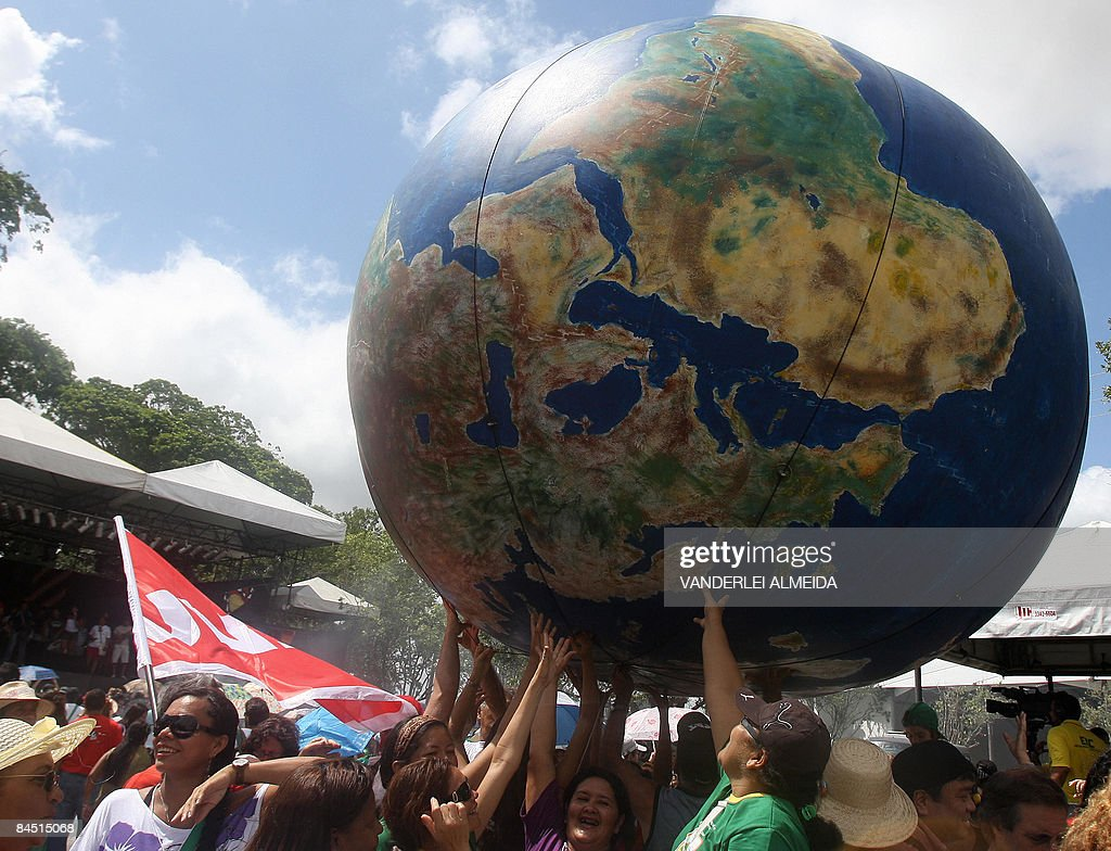 People transport a globe in a parade held during the World Social Forum in Belem in Para in the heart of the Brazilian Amazon on January 28 2009...