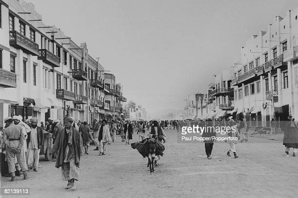 circa 1950 A Kabul street scene shows a new wide street crammed with people but no traffic