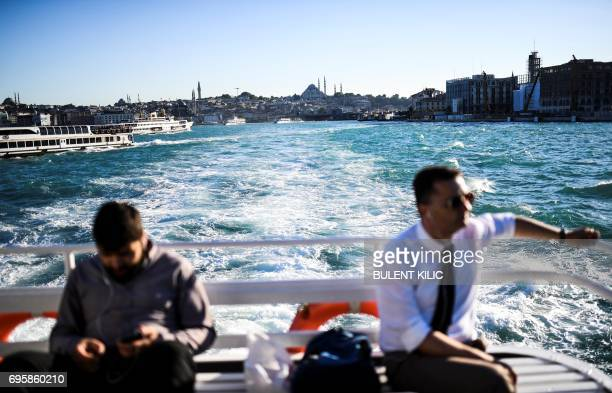 People travel by ferry boat on the Bosphorus after it has turned turquoise due to phytoplankton on June 14 in Istanbul The Moderate Resolution...