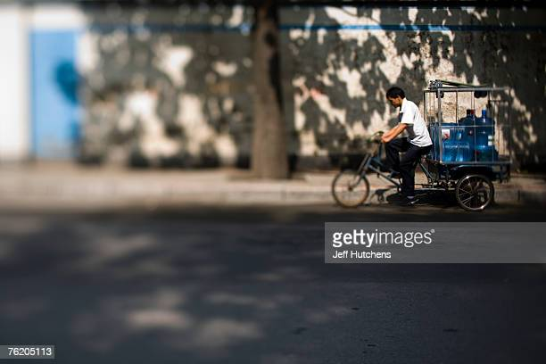 People travel through the streets on June 30 2006 in Beijing China China continues to open both socially and economically with the 2008 Summer...