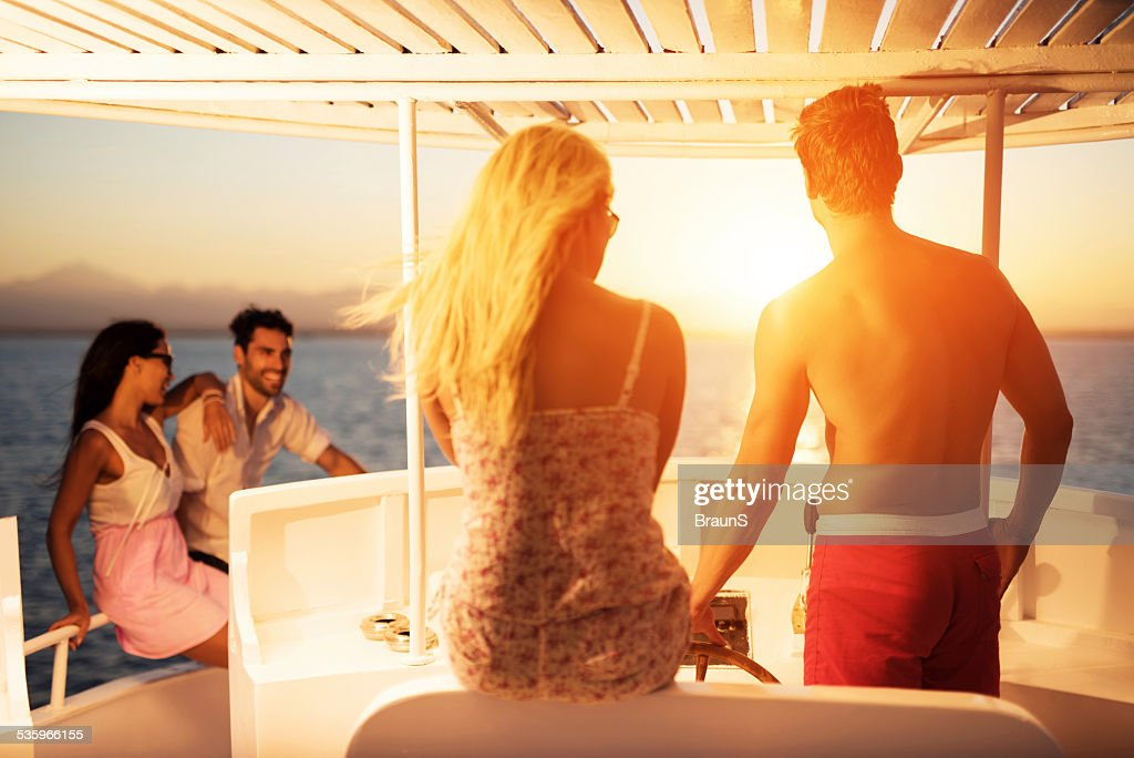 People traveling on a yacht at sunset. : Stock Photo