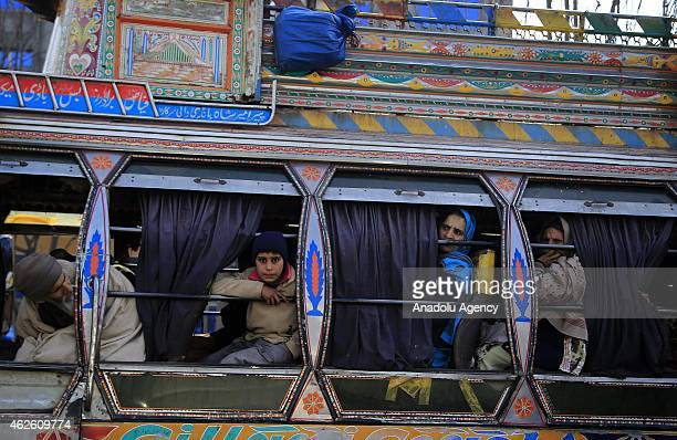 People traveling with a bus are seen in Muzaffarabad the capital of Pakistanadministered Azad Jammu and Kashmir on January 27 2015 Almost 4 million...
