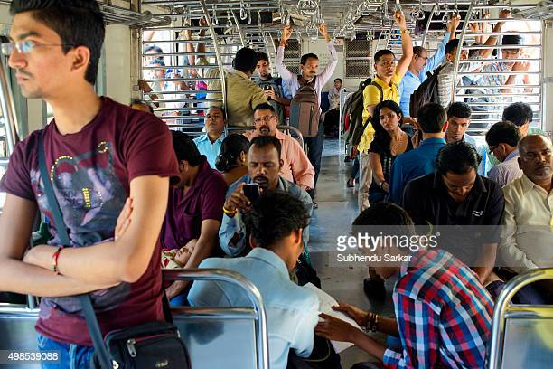 People travelling in a local train compartment in Mumbai