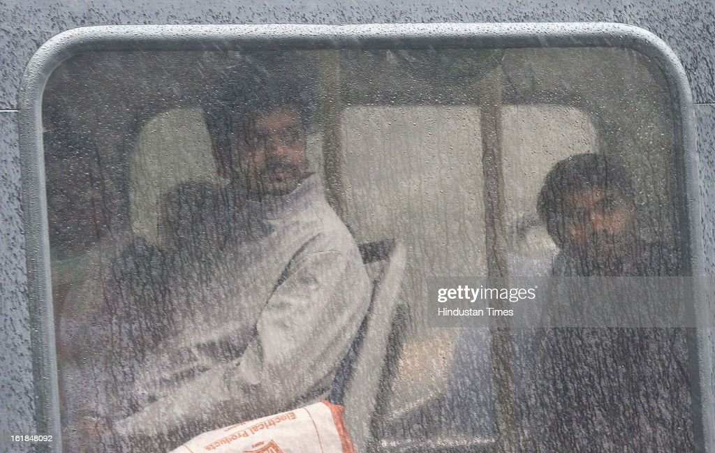 People travelling in bus during rainy weather on February 17, 2013 in New Delhi, India. The chilly weather in North India continues as rains lash several areas in Delhi, Uttarakhand, Himachal Pradesh and Uttar Pradesh.