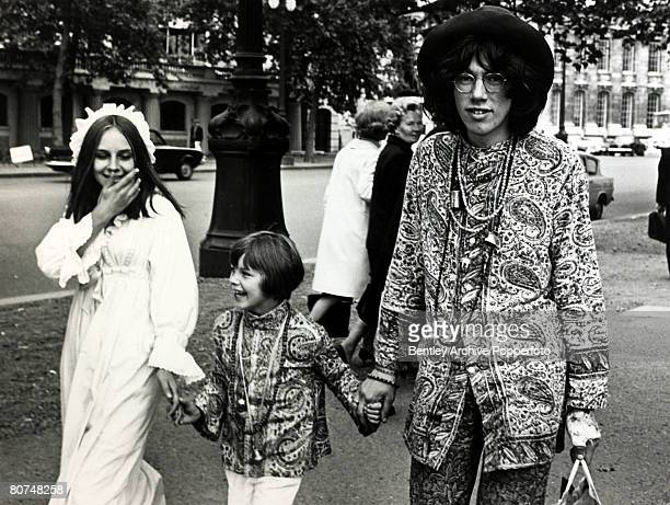 1968 A Hippy family walking along the Mall in London