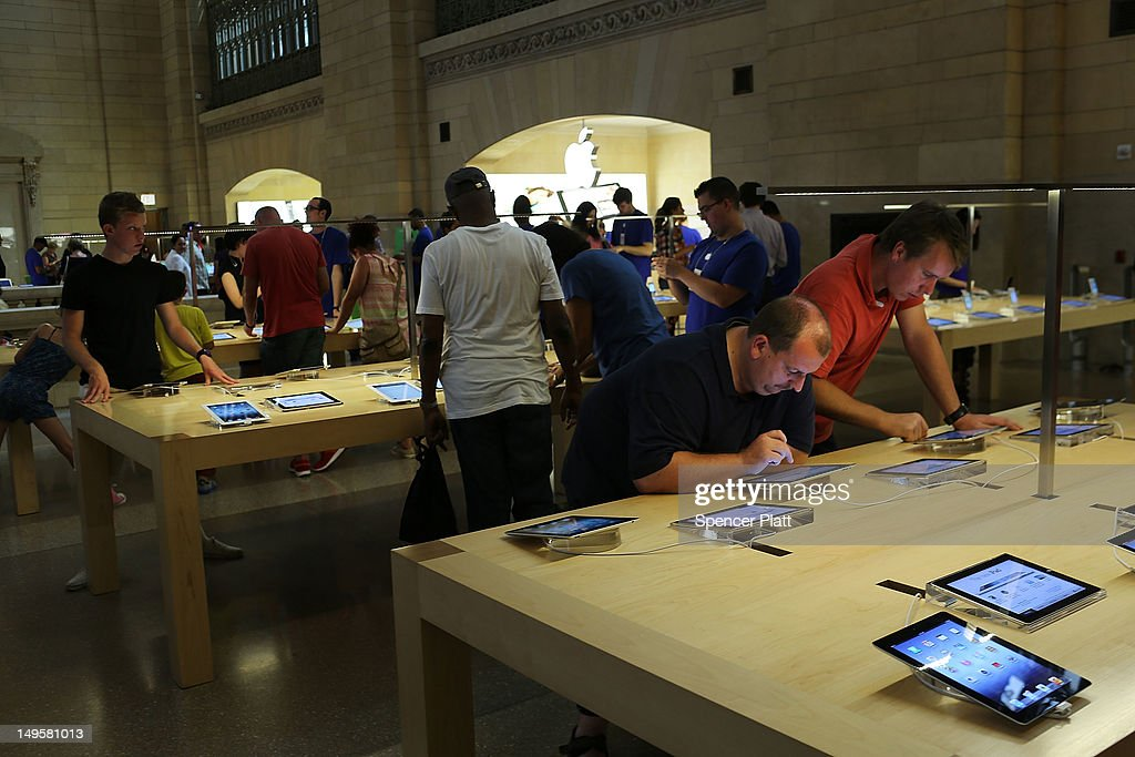 People try Apple products at the Apple store in Grand Central Terminal on July 31, 2012 in New York City. According to a new audit by New York State Comptroller Thomas DiNapoli, New York's Metropolitan Transportation Authority provided Apple Inc with an inside advantage securing a lease for the technology company's store in the coveted Grand Central Terminal.