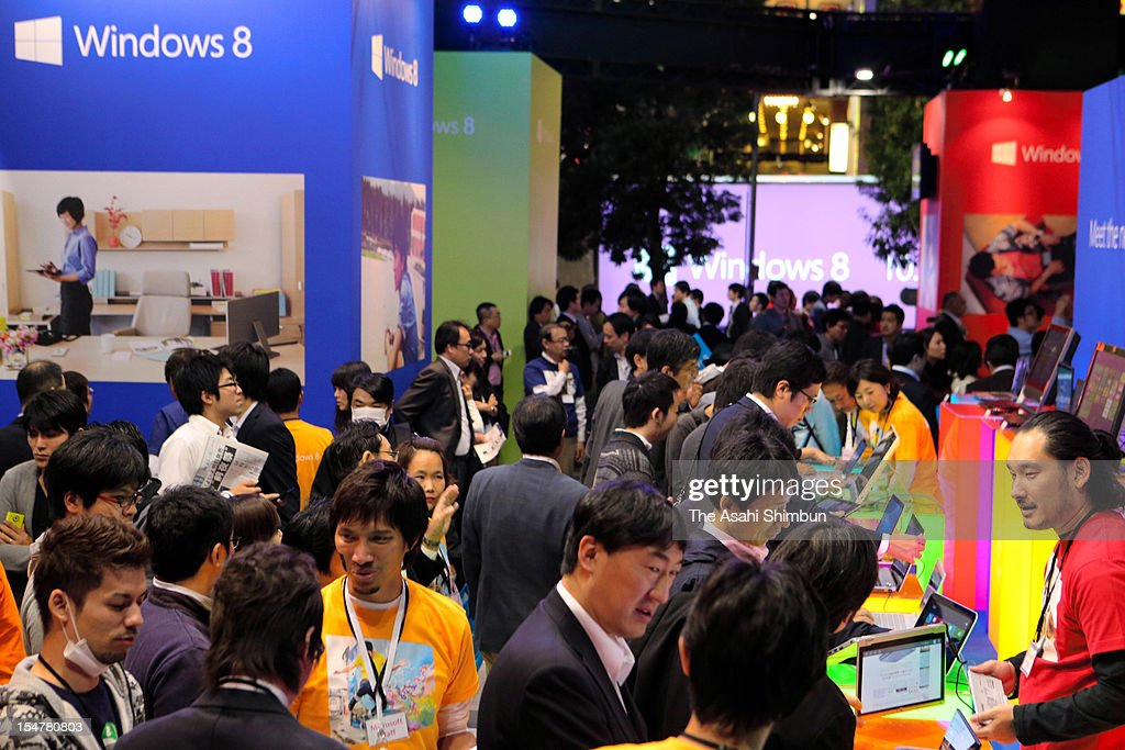 People try computers carrying Windows 8, the new operating system of Microsoft during the trial event on October 25, 2012 in Tokyo, Japan.