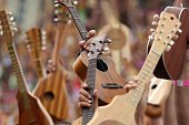 People try on April 11 2015 to beat the world record of ukelele players at the first Tahiti Ukulele Festival in Papeete with more than 4750...
