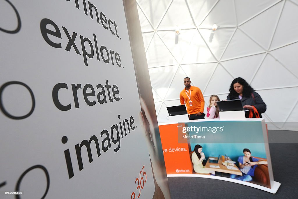 People try out devices at the Microsoft Office 2013 launch event in Bryant Park on January 29, 2013 in New York City. Microsoft is launching three versions, Office Professional 2013, Office Home & Student 2013 and Office Home & Business 2013.