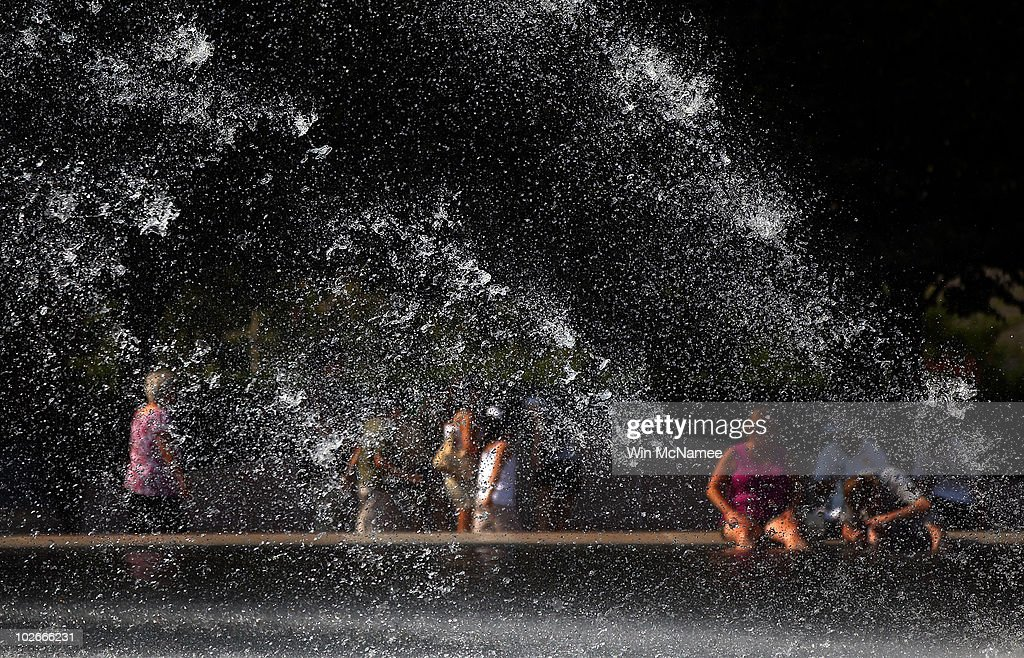 People try to cool off as they sit around the fountains at the National Gallery of Art Sculpture Garden July 6, 2010 in Washington, DC. Temperatures soared across the upper East Coast today with temperatures in the nation's capital reaching 102 degrees Fahrenheit.
