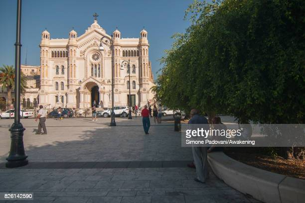 People try to cool off from the heat in the shadow of the trees of the square of the cathedral on August 03 2017 in Reggio Calabria Italy An intense...