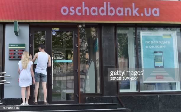 People try to enter a closed branch of Oschadbank on June 27 2017 in Kiev Wave of cyberattacks that began in Russia and Ukraine on June 27 was...
