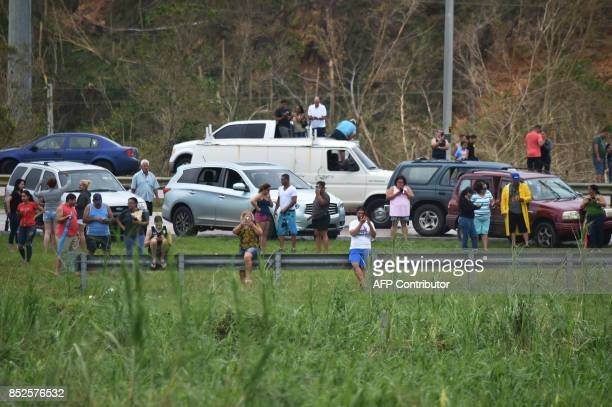 People try to get a cellphone signal in Dorado 40 km north of San Juan Puerto Rico on September 23 2017 Comunications electric power water supply and...