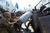 People try to pull shields away from officers as activists of radical Ukrainian parties including the Ukrainian nationalist party Svoboda clash with...