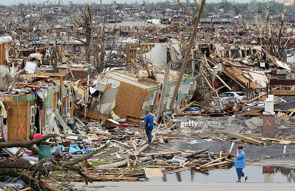 People try to salvage items from homes destroyed when a massive tornado passed through the town killing at least 116 people May 24 2011 in Joplin...