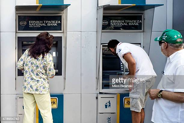 People try to use ATMs after Greece closed its banks on June 29 2015 in Athens Greece Greece closed its banks and imposed capital controls on Sunday...