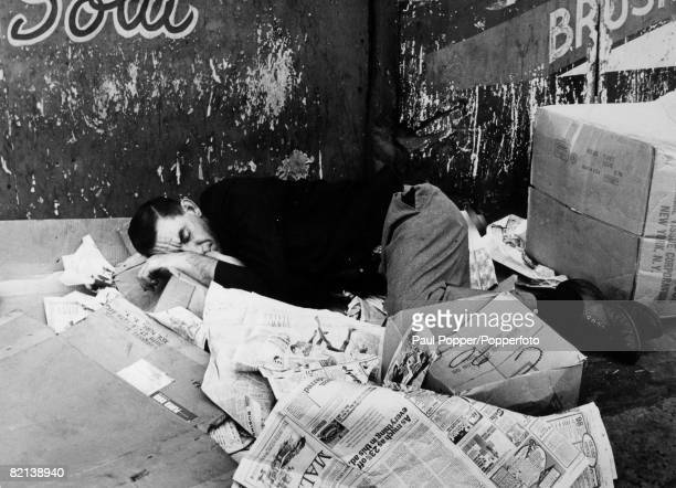 May 1970 USA New York City A picture taken in the 'Bowery' area of New York shows a beggar sleeping on heaps of newspapers and cardboard