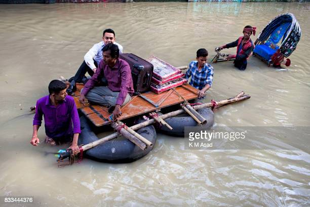 AGRABAD DHAKA CHITTAGONG BANGLADESH People use a makeshift boat made from rubber tires to move through a flooded area of Chittagong People traveling...