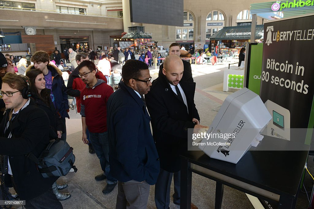 People use a newly installed Bitcoin ATM at South Station February 20, 2014 in Boston, Massachusetts. The ATM was placed by Liberty Teller to help inform people about the digital currency, which can be bought and sold anonymously, and can be used at a number of online retailers in place of cash or credit cards.