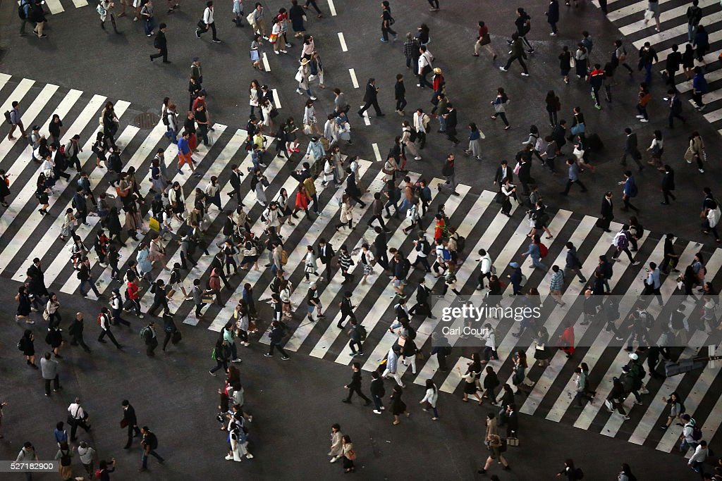 People use a pedestrian crossing on May 02, 2016 in the Shibuya area of Tokyo, Japan. The Greater Tokyo Area is the most populous metropolitan area in the world with a population of 13,506,607 and is currently ranked first in the world in the Safe Cities Index.