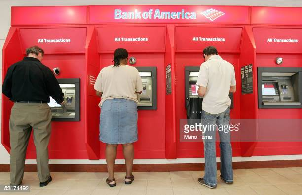 People use ATMs at a Bank of America branch is seen June 30 2005 in New York City Bank of America Corp the second largest US bank agreed to buy MBNA...