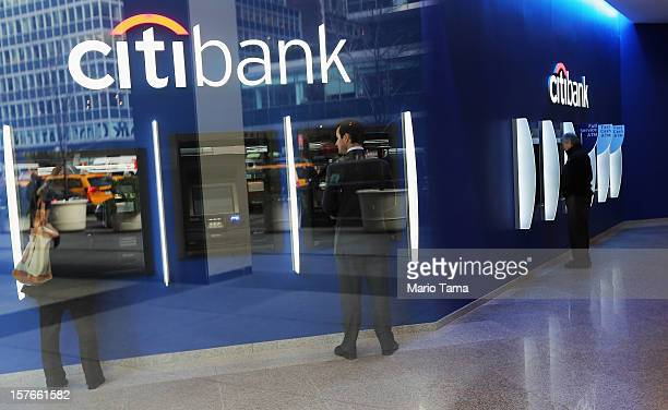 People use ATM's at Citibank headquarters in Manhattan on December 5 2012 in New York City Citigroup Inc today announced it was laying off 11000...