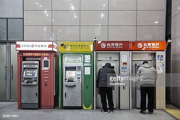 People use automated teller machines in Beijing China on Tuesday Jan 19 2016 China's economy slowed in December capping the weakest quarter of growth...