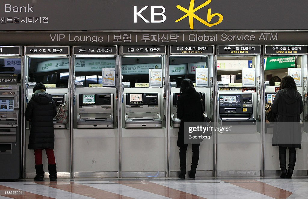 People use automatic teller machines (ATM) at a Kookmin Bank branch in Seoul, South Korea, on Thursday, Feb. 9, 2012. KB Financial Group Inc., owner of South Korea's largest lender, posted its lowest quarterly profit in a year on increased provisions for bad debts. Photographer: SeongJoon Cho/Bloomberg via Getty Images