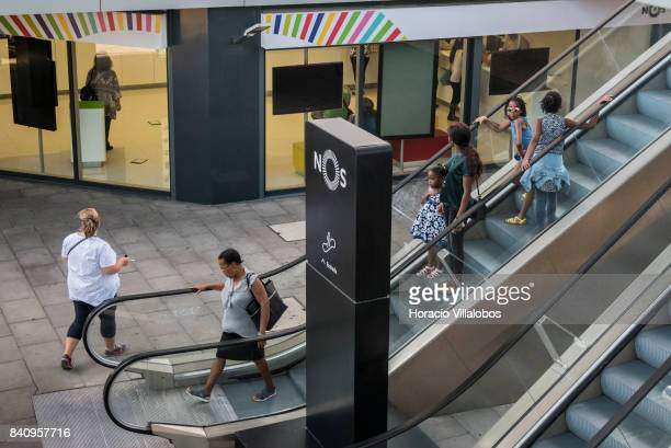People use escalators at the headquarters of Portuguese 'NOS Comunicacoes' a GSM/UMTS/LTE mobile operator on August 30 2017 in Lisbon Portugal Isabel...