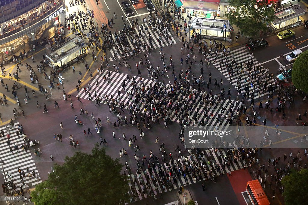 People use pedestrian crossings on May 02, 2016 in the Shibuya area of Tokyo, Japan. The Greater Tokyo Area is the most populous metropolitan area in the world with a population of 13,506,607 and is currently ranked first in the world in the Safe Cities Index.