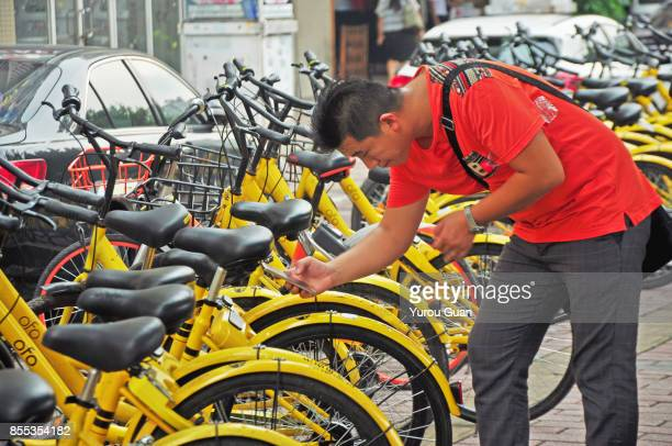 People use smartphone to scan the QR code on a shared bike to unlock it.