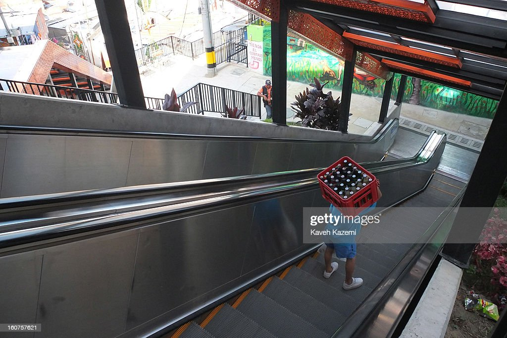 People use the escalators in '20 de Julio' neighborhood in the Comuna 13 slums on January 5, 2013 in Medellin, Colombia. The stairway is divided into six sections and has a length of 1,260 feet. An escalator goes up and a second goes down.Residents used to climb hundreds of steps to get home from the bottom of the hill, but the journey now takes just 6 minutes. Comuna 13 is the most notorious slums of Medellin with violence occurring everyday.