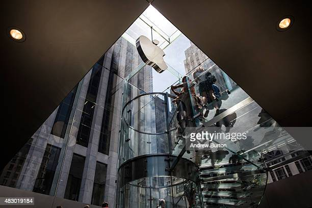 People use the spiral stair case at the Apple Store on Fifth Avenue on August 5 2015 in New York City Analysts at Bank of America Merrill Lynch...