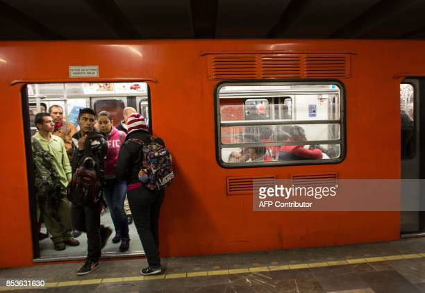 People use the subway system in Mexico City early on September 25 2017 almost a week after a magnitude 71 quake struck central Mexico Hopes of...