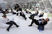 People use their phones in the relaxation area of the 2014 Mobile World Congress in Barcelona on February 25 2014 The Mobile World Congress runs from...