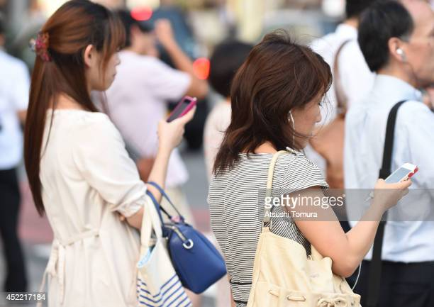 People use their smartphones on July 16 2014 in Tokyo Japan Only 535% of Japanese owned smartphones in March according to a white paper released by...