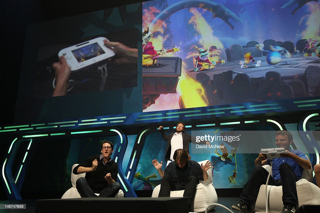 People use Wii U Pro controllers to play Rayman Legends on stage at the Ubisoft press conference on the eve of the Electronic Entertainment Expo (E3) on June 4, 2012 in Los Angeles, California. E3 is the most important yearly trade show the $78.5 billion videogame industry.