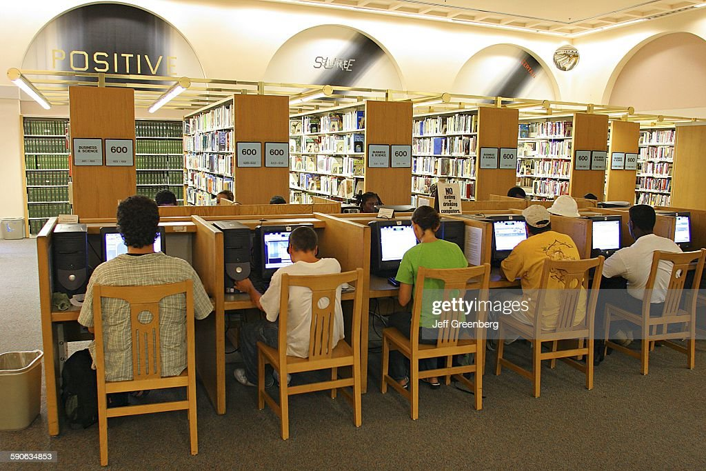 People Using Computers In A Public Library