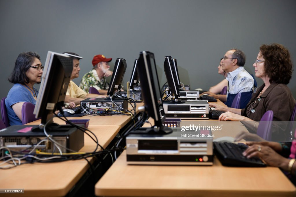 People using computers in computer lab