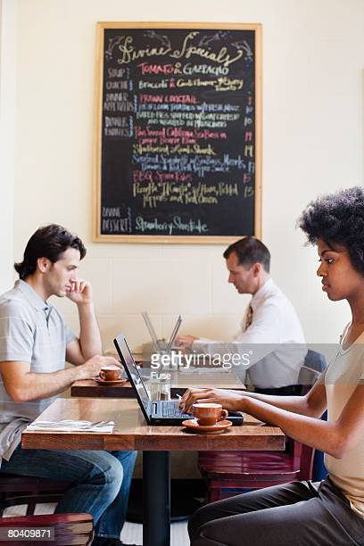 People Using Laptops in Cafe