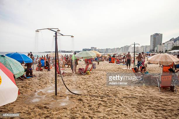 People using showers on the beach at Copacabana.
