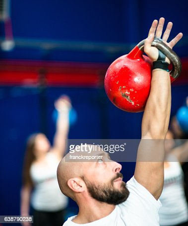 people using the kettlebell on the gym