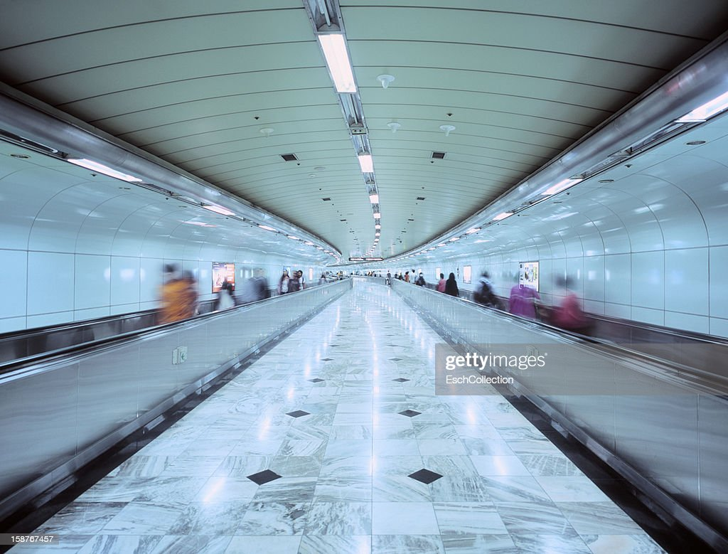 People using travolator at Gimpo Airport in Seoul : Stock Photo