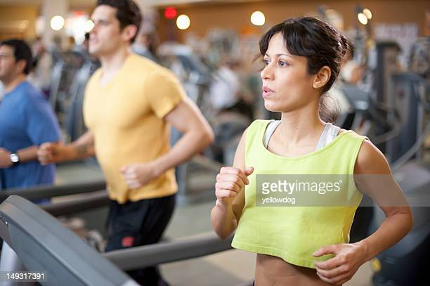 People using treadmills in gym