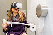 Girl in the bathroom with a VR (Virtual Reality) headset